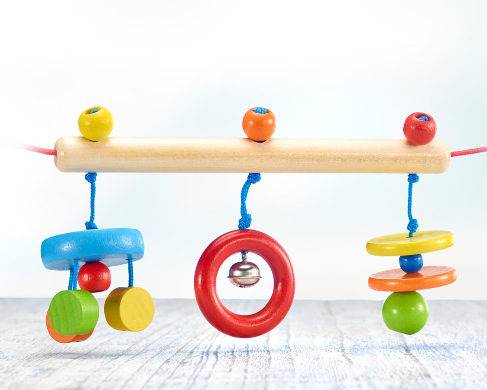 Holz bunte Kinderwagenkette mit Ringen, Scheiben und Glöckchen