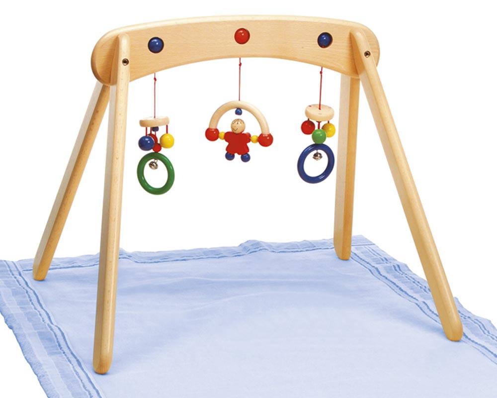 Holz buntes Babytrapez mit hängenden Kugeln, Ringen, Glöckchen und einem Männchen