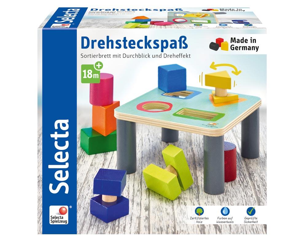 Verpackung Holz Bunter Sortiertisch mit verschiedenen Baukloetzen und komplexen Formen