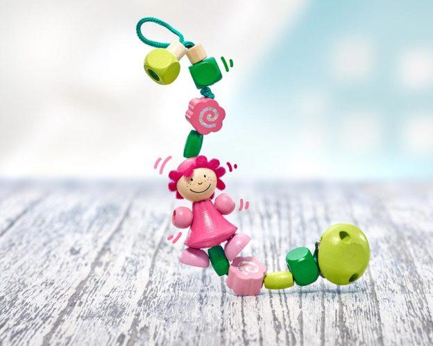 Holz grüne Schnullerkette mit rosa Mädchen und Holzklötzchen