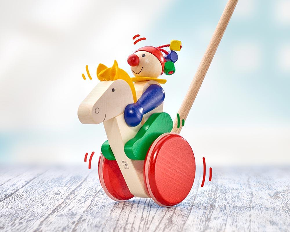 Holz Schiebefigur Reiter mit Pferd und Rädern