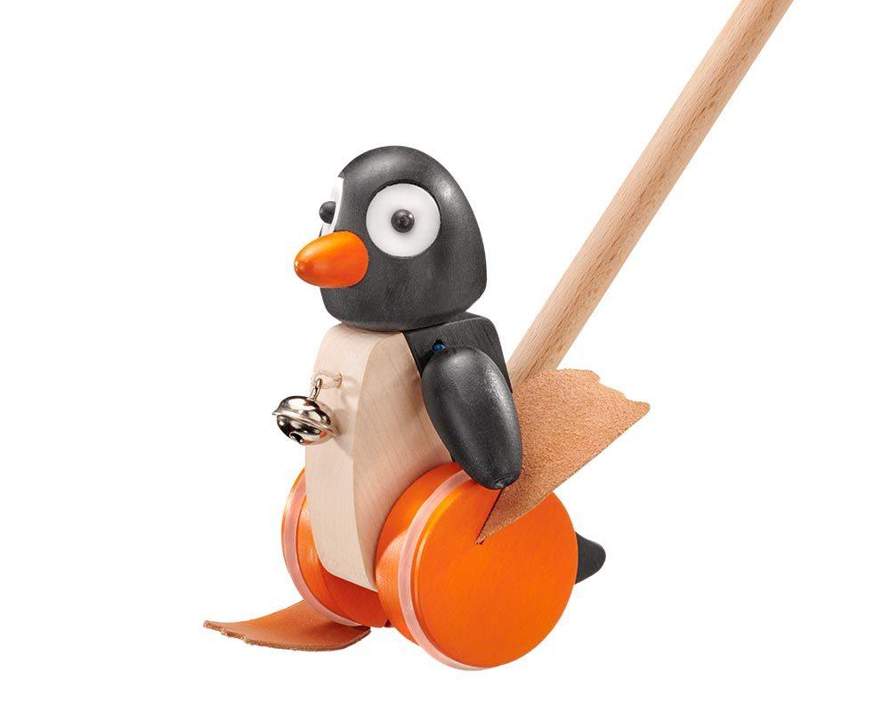 Holz Pinguin mit Glöckchen und Rädern